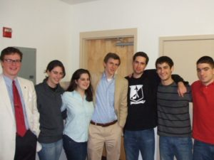 Flanking James O'Keefe (center) is members of the White Supremacist group Youth for Western Civilization. Christine Rousselle, currently a web-editor and contributor for TownHall.com, is on the left and Timothy Dionisopoulos, who is currently working with US Immigration Reform PAC (USIRPAC), is on the right wearing the YWC T-Shirt.